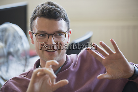 smiling businessman gesturing explaining