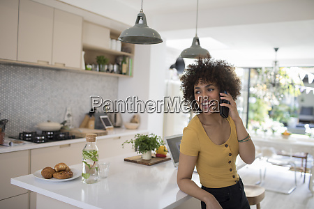 happy young woman talking on smart