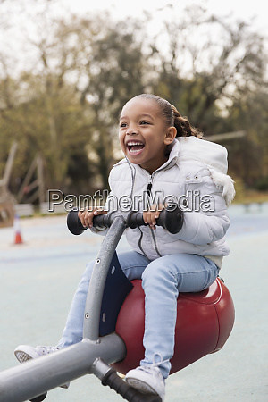 playful happy girl playing on playground