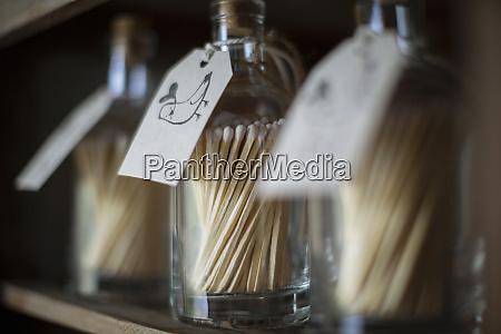 close up matchstick bottles with bird