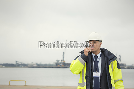 dock manager using walkie talkie at