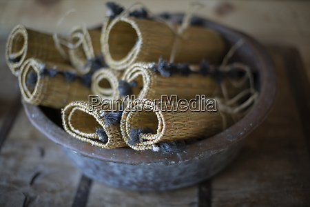 rolled up rustic straw placemats in