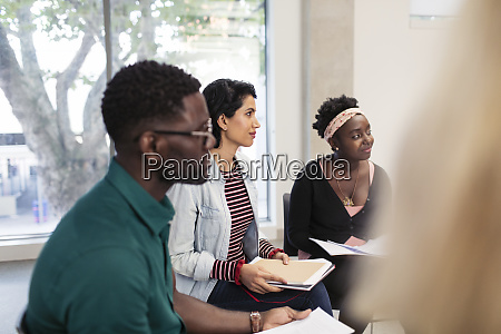 attentive business people listening in meeting