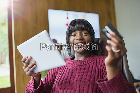 portrait happy young woman online shopping