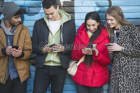 young adults using smart phones