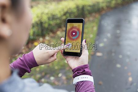 female, runner, checking, heart, rate, monitor - 28127842