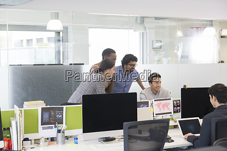 business people meeting at computer in