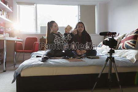 teenage girls vlogging demonstrating makeup application