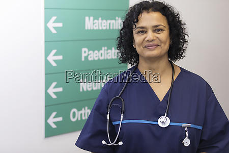 portrait confident female doctor in hospital