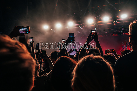 crowd with smart phones filming music