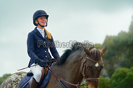 confident smiling teenage girl equestrian horseback