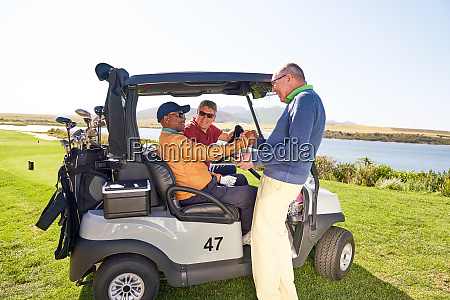 male golfer friends talking at golf