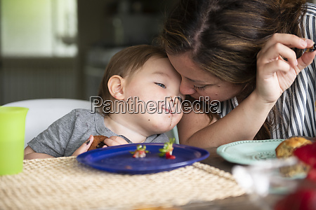 close up affectionate mother and toddler