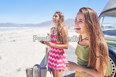 happy young women friends laughing on