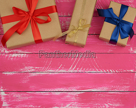 gifts wrapped in brown kraft paper