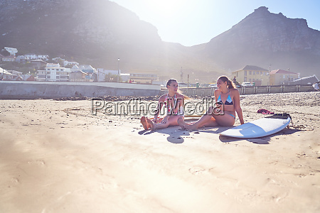 young, female, surfer, friends, with, surfboards - 28130443