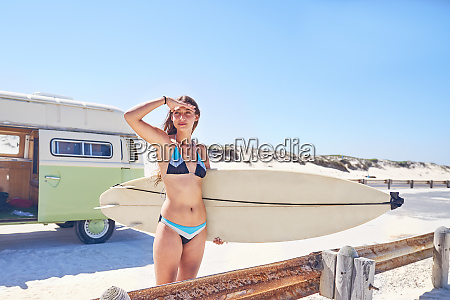 young, female, surfer, with, surfboard, on - 28130435