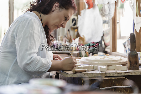 woodcarver cutting fine woodworks in bulgarian