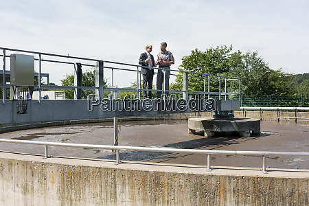 worker and manager standing on metal