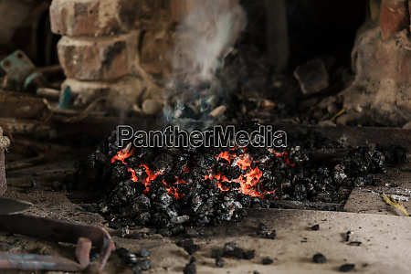fire burning down in furnace of