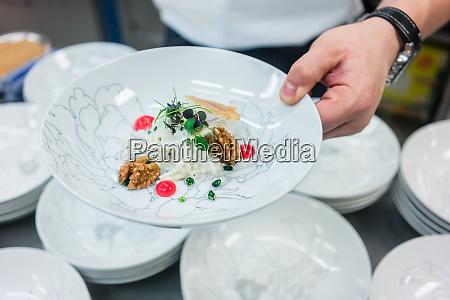 master chef presenting savory vegetarian food
