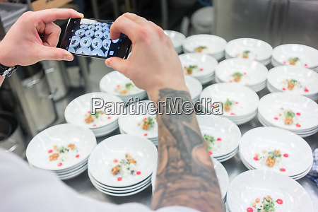chef photographing savory dish with a