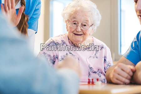 seniors and staff in retirement home