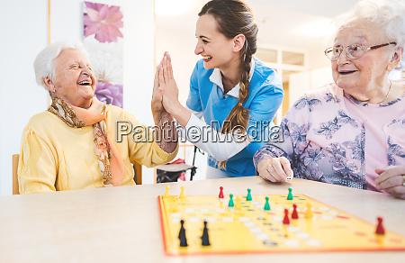 seniors and nurses giving high five