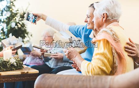 grandmother and nurse taking christmas selfie