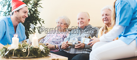 seniors and nurses celebrating christmas in