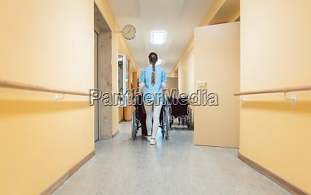 nurse helping a senior man in