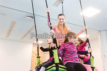 teacher and children in preschool doing