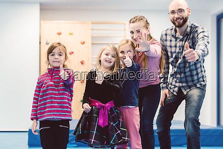 kindergarten children and the teachers showing