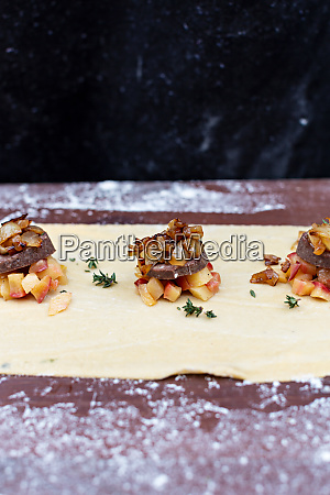 making of ravioli with meat onion
