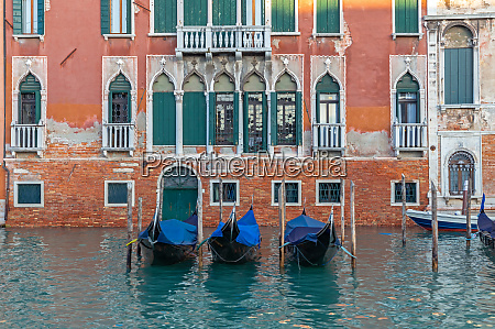 parked gondolas on grand canal in