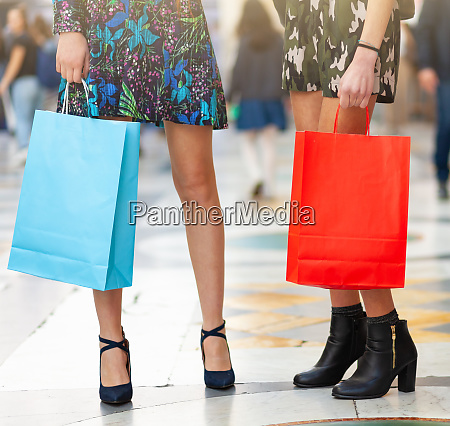 closeup of legs and shopping bags