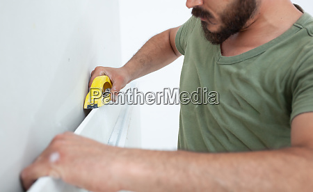 worker building plasterboard wall