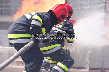 firefighters in action firefighting
