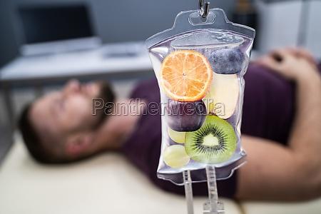 fruit slices inside saline bag hanging
