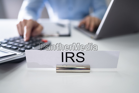 irs nameplate in front of accountant