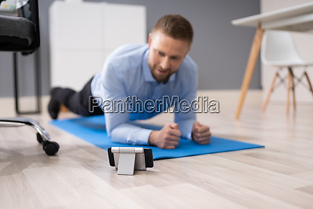 businessman exercising using smartphone app