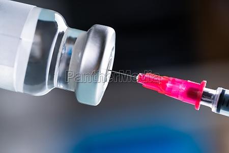 filling shingles vaccine syringe