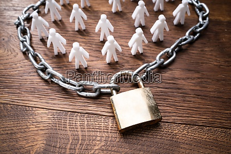 person figures surrounded by chain and