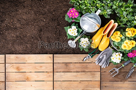 gardening tools and flowerpots in garden