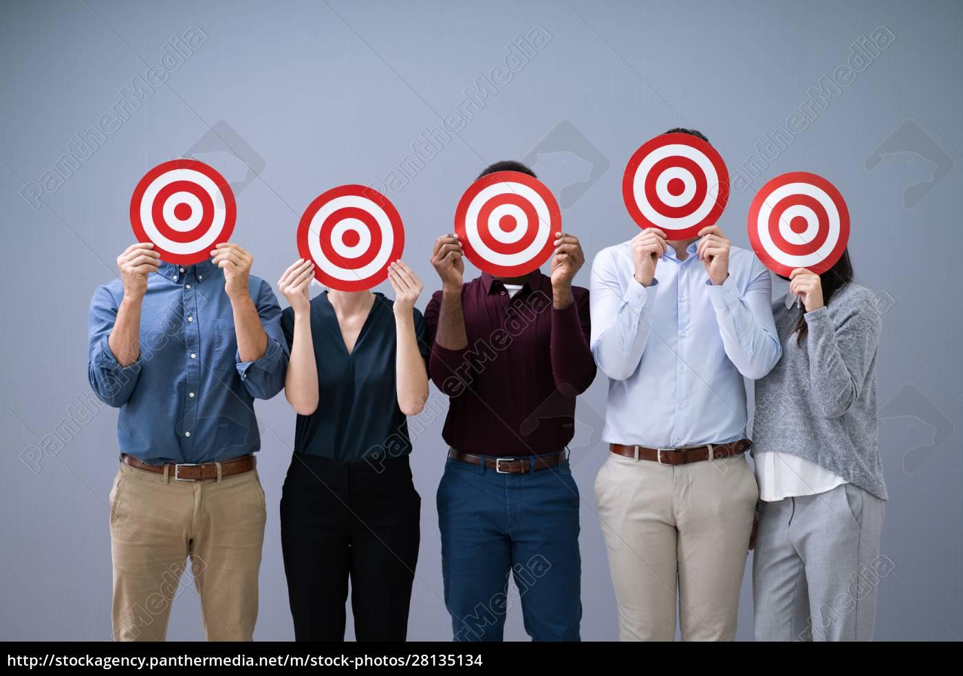 businesspeople, holding, dartboard - 28135134