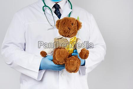pediatrician in white coat blue latex