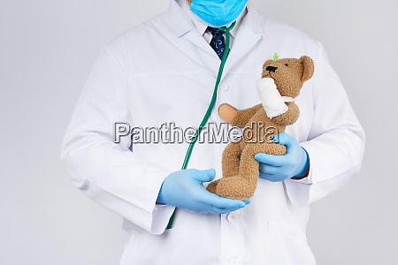 pediatrician in a white coat blue