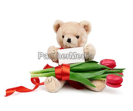 beige teddy bear sitting on an
