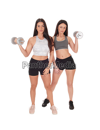 two woman exercising with dumbbells in