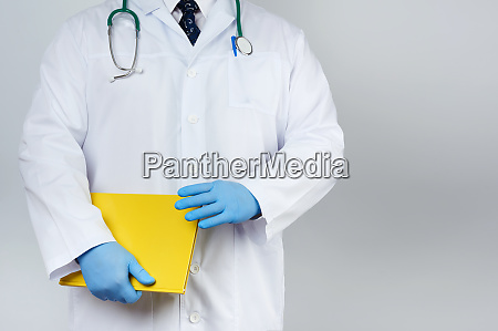 male doctor standing in a white